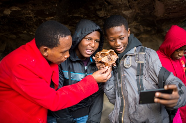 ScienceSpaza_ NSW 2017_ Trip_ Learners takie_a_selfie _with_ a fossil_model.jpeg